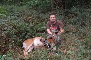 Frankie with his first bow buck kill with the bow and arrow!
