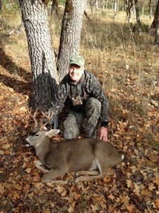 Mike A. with David's Blacktail Buck on the ground!