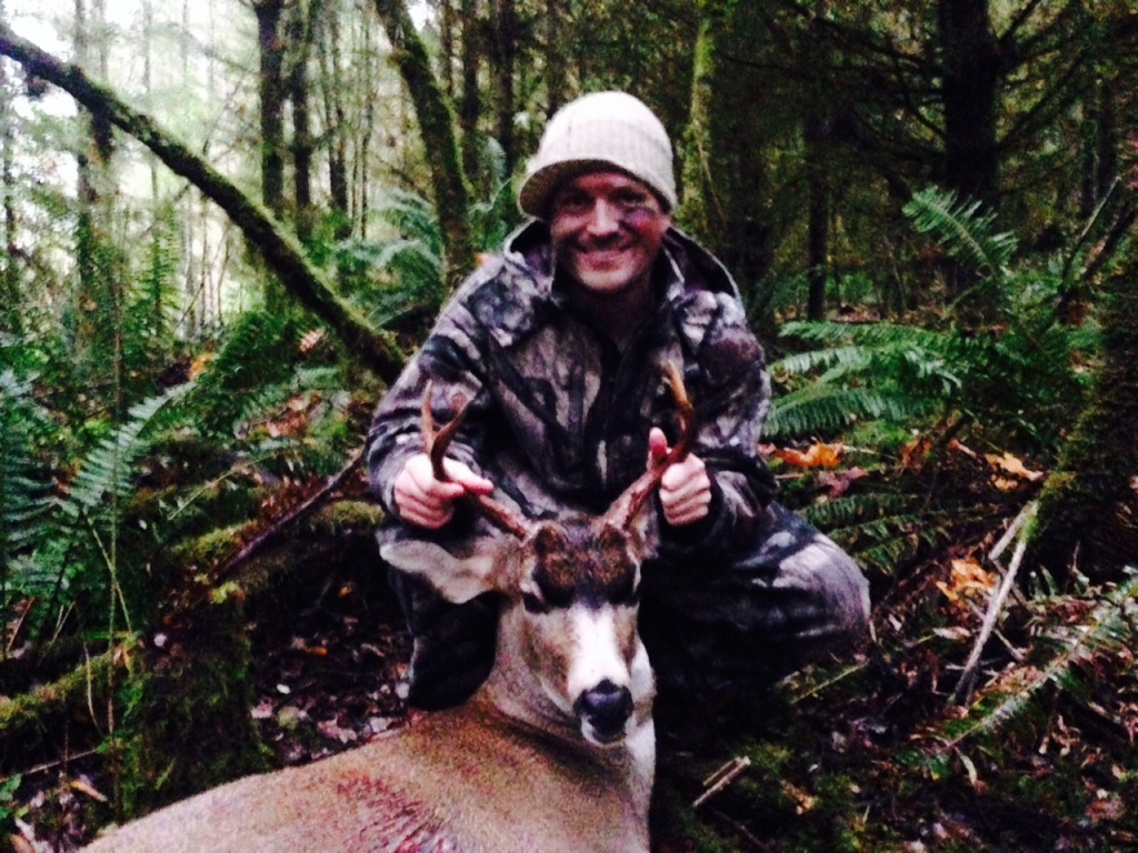 Jake with his first Blacktail Buck from the State of Washington, near La Center, Washington!